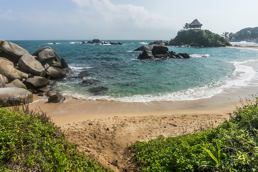 Caribbean sea entering the bay at Cabo San Juan in Tayrona National park near Santa Marta, Colombia.  The park is one of the most popular tourist destinations on Colombia's Caribbean coast.