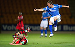 St Johnstone v St Mirren...20.09.11   Scottish Communities League Cup Third Round.Jim Goodwin slides in on Chris Millar.Picture by Graeme Hart..Copyright Perthshire Picture Agency.Tel: 01738 623350  Mobile: 07990 594431