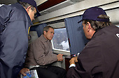 United States President George W. Bush tours the World Trade Center disaster site aboard Marine One with New York Mayor Rudolph Giuliani, left, and New York Governor George Pataki, Friday, September 14, 2001..Mandatory Credit: Eric Draper - White House via CNP
