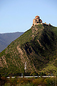 An old church is perched on top of a mountain at the ancient Georgian capital of Mtskheta.