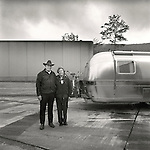 Couple at roadside rest with 11804 Airstream Travel Trailer. 1976