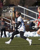 Boston College midfielder Kate McCarthy (20) looks to pass..Boston College (white) defeated Boston University (red), 12-9, on the Newton Campus Lacrosse Field at Boston College, on March 20, 2013.