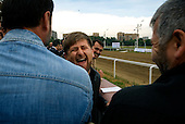 """Chechen President Ramzan Kadyrov celebrates after his horse won the race in Moscow's Hippodrome. .Kadyrov's horse, """"Royal Quiet"""", came first in the 1600-metre race. .The horse, born in the U.S.A., is parented by father: Real Quiet, mother: Dinasoar, is trained by S. G. Kolesnikov and rode by master jockey S. V. Petin."""