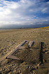 Discarded door on Dollymount strand, Bull Island, Dublin, two weeks after I first photographed it...Bull Island is a UNESCO protected biosphere reserve in the Northern suburbs of Dublin. It features two golf clubs, and Dollymount beach, used for kitesurfing and other outdoor activities. Wildlife includes seals and bird life.<br />