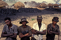 Workers` portrait, vegetal charcoal production, unhealthy job, no personal protective equipment, dirty faces. Brazil, Mato Grosso do Sul State.