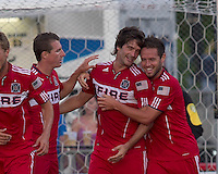 Chicago Fire forward Diego Chaves (99) celebrates his goal with teammates. In a Third Round U.S. Open Cup match, the Chicago Fire defeated the Rochester Rhinos, 1-0, at Sahlens Stadium on June 28, 2011.