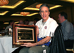 """Jon Stewart, host of Comedy Central's """"The Daily Show"""" shows off his plaque declaring him to be an NSCAA Honorary All-America on Saturday, January 21st, 2006, during the National Soccer Coaches Association of America's annual convention in the Grand Ballroom of the Pennsylvania Convention Center in Philadelphia, PA."""