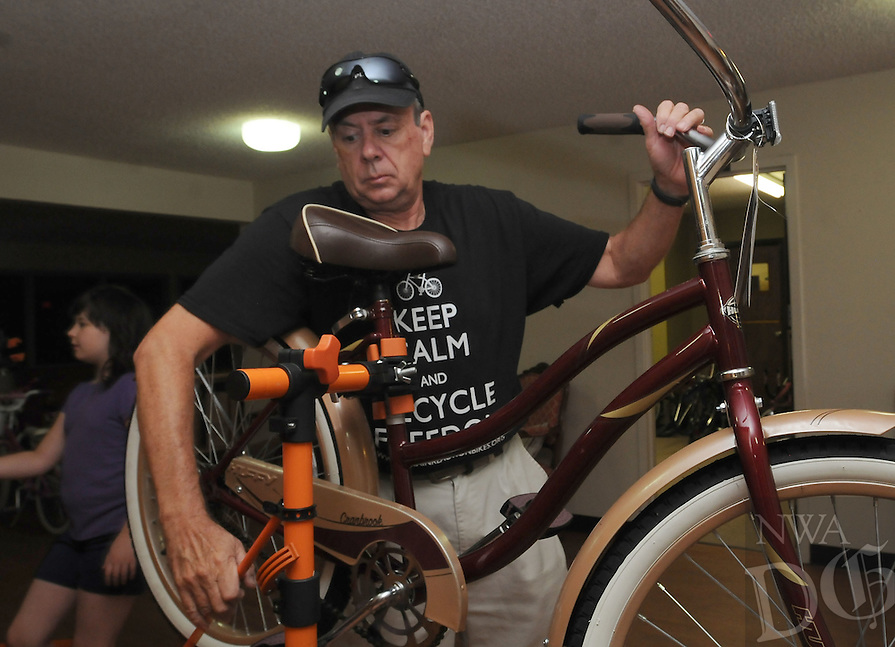 NWA Democrat-Gazette/FLIP PUTTHOFF<br /> Bill Eby works on a bike Saturday August 8 2015 at First Christian Church in Bentonville.