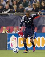 New England Revolution defender Darrius Barnes (25) passes the ball. In a Major League Soccer (MLS) match, the New England Revolution defeated FC Dallas, 2-0, at Gillette Stadium on September 10, 2011.