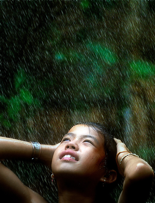 A girl in Luang Prabang province, Laos is able to take a shower because of improved water supplies.
