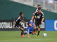 El Salvador National Team forward Rodolfo Zelaya (11) gets fouled by DC United forward Chris Pontius (13) right and DC United midfielder Clyde Simms (19) left.  DC United defeated El Salvador National Team 1-0 in a international charity match at RFK Stadium, Saturday June 19, 2010.