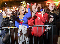 Young women spectators cheer the 41st Annual Halloween Parade. 10.31.2014. Photo by Marco Aurelio/VIEWpress