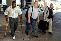 Former Green Bay Packers defensive back Willie Wood, left, Vince Lombardi Jr., right and an unidentified player arrive in Green Bay, Wisconsin in September of 2001 for the Vince Lombardi Titletown Legends reunion.