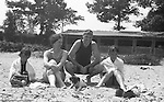 Markleysburg PA:  Stewart family camping and swimming at Youghiogheny Lake - 1931.  Brady Jr., Brady Sr., Sara and Sally Stewart relaxing on the beach with Pepe (their dog)>
