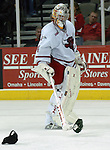 10/20/06 Omaha, NE  University of Nebraska at Omaha goalie Jerad Kaufmann picks up hats thrown onto the ice after a Brandon Scero at Qwest Center Omaha..(Chris Machian/Prairie Pixel Group)..UNO won in the first game of the Maverick Stampede.