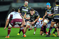 Lloyd Ashley of the Ospreys takes on the Bordeaux Begles defence. European Rugby Champions Cup match, between the Ospreys and Bordeaux Begles on December 12, 2015 at the Liberty Stadium in Swansea, Wales. Photo by: Patrick Khachfe / JMP