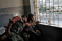 Free Syria Army soldiers look through a mirror in order to pin-point the positions of regime loyalist positions in the Bustan Al-Bashar neighborhood of Aleppo on the last day of a U.N.-negotiated seize fire that began on the first day of the Muslim holiday of Eid. Both sides exchanged small arms fire as the regime fired mortars throughout the day on several sectors of the city - the kurdish neighborhood of Ashrafya was also bombed by regime jets on October 29, 2012, following an FSA incursion in the district on Saturday...© Javier Manzano......................................................