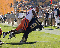 Syracuse Cornerback Nick Chestnut breaks up a pass intended for Pitt Panther Wide Receiver T.J. Porter on November 03, 2007 at Heinz Field, Pittsburgh, Pennsylvania. Despite Chestnut's efforts the Syracuse Orange lost the game 20-17.