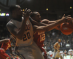 "Ole Miss guard Nick Williams (20) battles with Arkansas' Marcus Britt (12) for the ball at C.M. ""Tad"" Smith in Oxford, Miss. on Saturday, March 5, 2010. Ole Miss won 84-74."