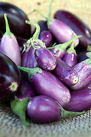Detail of a dish of fresh aubergines