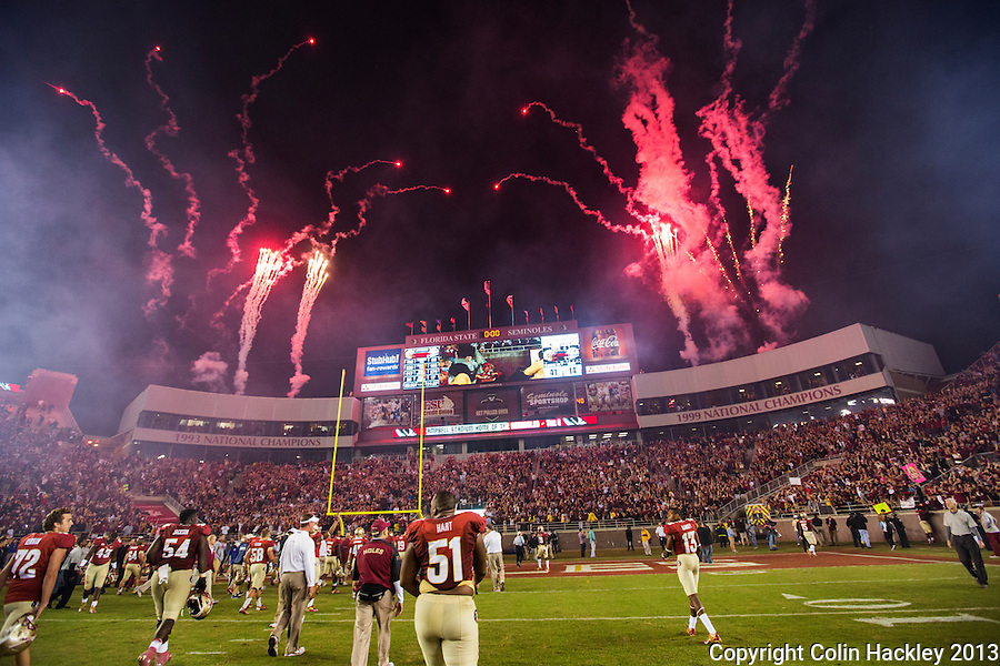TALLAHASSEE, FL 11/2/13-FSU-MIAMI110213CH-Florida State players leave the field under fireworks after the Miami game Saturday at Doak Campbell Stadium in Tallahassee. The Seminoles beat the Hurricanes 41-14.<br /> COLIN HACKLEY PHOTO