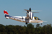 Side view of the final flight of the XV-15 tilt rotor aircraft at the National Air and Space Museum's new Steven F. Udvar-Hazy Center near Washington Dulles International Airport in Herndon, Virginia on September 16, 2003.  Tilt rotors are a unique type of aircraft that possess the take-off, hover and landing capabilities of a conventional helicopter with the range and speed of a turboprop aircraft.  Tilt rotor flight research began in the 1950s with the Bell XV-3 convertiplane.  NASA's Ames Research Center, Moffett Field, Calif., in partnership with the U.S. Army, developed design specifications for a new aircraft to demonstrate the viability of the tilt rotor concept.  After extensive ground, wind tunnel and simulator tests at Ames, the first of two XV-15s, built by Bell Helicopter Textron, took its maiden flight on May 3, 1977.  The success of the XV-15 has led to the development of the V-22 Osprey and the world's first civil tilt rotor, the nine-passenger Bell Agusta 609, now under development and scheduled for deliveries in 2007.  The National Air and Space Museum, comprised of the Udvar-Hazy Center, which is scheduled to open to the public on December 15, 2003, and the museum's building on the National Mall, .will be the largest air-and-space-museum complex in the world. .Credit: Ron Sachs / CNP