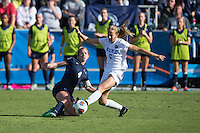 Cary, North Carolina - Sunday December 6, 2015: Megan Schafer (4) of the Penn State Nittany Lions tries to steal the ball from Rebecca Quinn (5) of the Duke Blue Devils during second half action at the 2015 NCAA Women's College Cup at WakeMed Soccer Park.  The Nittany Lions defeated the Blue Devils 1-0.