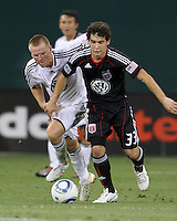 Martin Rivas #33 of D.C. United gets away from Matthew Ritchie #3 of Portsmouth FC during an international friendly match at RFK Stadium on July 24 2010, in Washington D.C.United won 4-0.