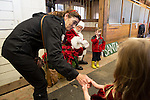 A mom encourages her daughter to say hello to Santa at the Annual Holiday Barn Lighting at Westwind Barn in Los Altos Hills Dec. 2.