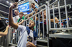 Mar. 18, 2015; Bonzie Colson takes a selfie with fans after practice at the Consol Energy Center before the second round of the 2015 NCAA Tournament. (Photo by Matt Cashore/University of Notre Dame)