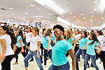"Flash Mob dance event for Estee Lauder at Macy's in Long Island, New York, USA, on July 23, 2011. Teal shirts dancers wearing have ""Imagine having nothing to hide"" written on front."