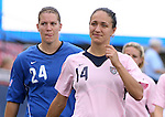 The United States' Stephanie Lopez (14), wearing a special pink Breast Cancer Awareness jersey, and backup goalkeeper Nicole Barnhart (24) on Saturday, May 12th, 2007 at Pizza Hut Park in Frisco, Texas. The United States Women's National Team defeated Canada 6-2 in a women's international friendly.