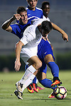 27 September 2016: Duke's Jared Golestani (behind) knocks the ball away from Georgia State's Nick Hague (ENG) (in white). The Duke University Blue Devils hosted the Georgia State University Panthers at Koskinen Stadium in Durham, North Carolina in a 2016 NCAA Division I Men's Soccer match. Georgia State won the game 2-1 in two overtimes.