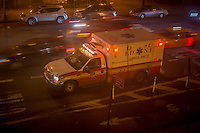 An FDNY ambulance is parked outside an apartment building as the EMT's visit a patient in the Chelsea neighborhood of New York on Thursday, May 23, 2013.  (© Richard B. Levine)