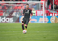 Toronto, Ontario - May 3, 2014: Toronto FC midfielder Jonathan Osorio #21in action during a game between the New England Revolution and Toronto FC at BMO Field.<br /> The New England Revolution won 2-1.
