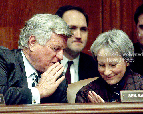 """Washington, DC - (FILE) -- United States Senators Edward M. """"Ted"""" Kennedy (Democrat of Massachusetts), Chairman, left, and Nancy Landon Kassebaum (Republican of Kansas), ranking member, right, discuss the nomination of Robert Reich as Secretary of Labor during a hearing of the Senate Committee on Labor and Human Resources in Washington, D.C. on January 7, 1993..Credit: Ron Sachs / CNP"""