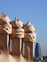 Chimneys with Agbar tower built by Jean Nouvel in the distance, Roof, La Pedrera (Casa Milà), Barcelona, Catalonia, Spain, built by Antoni Gaudí (Reus 1852 ? Barcelona 1926), 1906 - 1910, for  Milà Family, with Joan Beltran as a plaster and with Josep Maria Jujol as architect collaborator. One of the main Gaudi residential buildings. Picture by Manuel Cohen