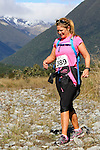 NELSON LAKES, NEW ZEALAND - APRIL 18:  KylieWilliamson crosses the Travers River during the 2015 Alpine Lodge Loop The Lake trail run at Lake Rotoiti on April 18 16, 2015 in Nelson, New Zealand. (Photo by Marc Palmano/Shuttersport Limited)