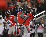Ole Miss tight end Jamal Mosley (17), Ole Miss offensive lineman A.J. Hawkins (76), and Ole Miss wide receiver Donte Moncrief (12) celebrate a touchdown at Vaught Hemingway Stadium in Oxford, Miss. on Saturday, November 24, 2012. Ole Miss won 41-24.