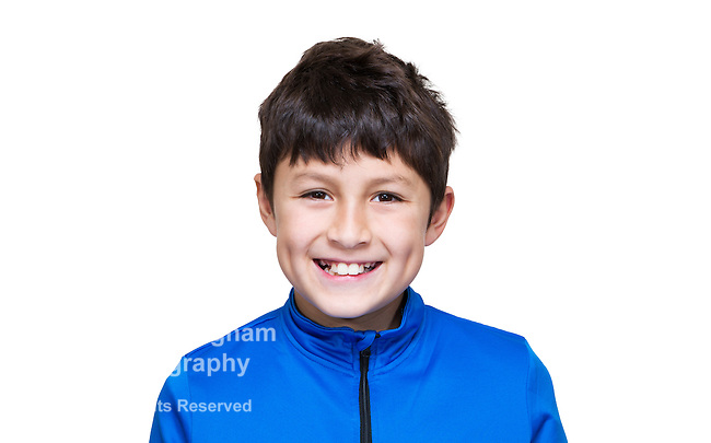 Young modern boy in blue jacket on white background