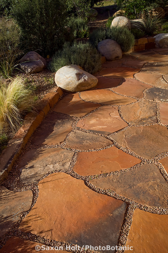 Flagstone patio using stones set in pervious pebbles for water drainage in New Mexico garden