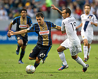 CARSON, CA - July 4, 2012: Philadelphia Union midfielder Michael Farfan (21) and LA Galaxy midfielder Juninho (19) during the LA Galaxy vs Philadelphia Union match at the Home Depot Center in Carson, California. Final score LA Galaxy 1, Philadelphia Union 2.