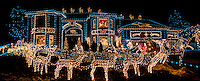 Holiday decorations and lights stretch from the lawn to the roof in this panoramic image of a house in Broomfield, Colorado.