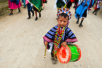 """A child from the Kamentsá tribe, wearing a colorful costume, plays drum during the Carnival of Forgiveness, a traditional indigenous celebration in Sibundoy, Colombia, 12 February 2013. Clestrinye (""""Carnaval del Perdón"""") is a ritual ceremony kept for centuries in the Valley of Sibundoy in Putumayo (the Amazonian department of Colombia), a home to two closely allied indigenous groups, the Inga and Kamentsá. Although the festival has indigenous origins, the Catholic religion elements have been introduced and merged with the shamanistic tradition. Celebrating annually the collaboration, peace and unity between tribes, they believe that anyone who offended anyone may ask for forgiveness this day and all of them should grant pardons."""