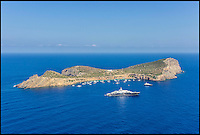 BNPS.co.uk (01202 558833)<br /> Pic: Kuhn&amp;Partner/BNPS<br /> <br /> The 100ft superyacht which can be rented for &pound;60,000 a week sits in front of the island.<br /> <br /> Go on, push the boat out...<br /> <br /> Wealthy revellers wanting to spend their Ibiza holiday in the lap of luxury can now rent this entire island half a mile off the coast - but they will have to fork out a staggering &pound;12,000 a night for the privilege.<br /> <br /> Deep-pocketed holidaymakers can get a taste of life as a celebrity on 98-acre Tagomago Island, which features its own plush villa for 10 people, a fully-stocked bar and nine staff to wait on them hand and foot.<br /> <br /> Nestled in the crystal-clear turquoise waters of the Mediterranean, the tiny private island has recently played host to footballing star Cristiano Ronaldo and Rolling Stones guitarist Ronnie Wood.<br /> <br /> Tagomago can be hired for a whopping &pound;85,000 a week at the height of summer - the equivalent to &pound;500 an hour - but prices drop to an only slightly more affordable &pound;70,000 for the rest of the year.