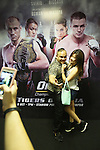 ONE VIP area during fight. Some punters act out scenes for photo opportunities in front of a poster of the MMA stars<br />