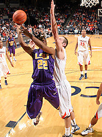 Jan. 2, 2011; Charlottesville, VA, USA; LSU Tigers guard Ralston Turner (22) is defended by Virginia Cavaliers forward Will Regan (4) during the game at the John Paul Jones Arena. Virginia won 64-50. Mandatory Credit: Andrew Shurtleff-