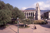 Two Maya women crossing the Parque Centroamerica, the main plaza in the city of Quetzaltenango, Guatemala