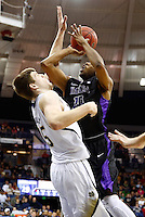 SOUTH BEND, IN - DECEMBER 21: Juan'ya Green #10 of the Niagara Purple Eagles shoots the ball against Jack Cooley #45 of the Notre Dame Fighting Irish at Purcel Pavilion on December 21, 2012 in South Bend, Indiana. (Photo by Michael Hickey/Getty Images) *** Local Caption *** Juan'ya Green; Jack Cooley