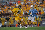 29 MAY 2011: Spencer Smith (40) of Salisbury University moves the ball against Ryan Jorgensen (3) of Tufts University during the Division III Men's Lacrosse Championship held at M+T Bank Stadium in Baltimore, MD.  Salisbury defeated Tufts 19-7 for the national title. Larry French/NCAA Photos